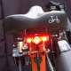 Brompton CatEye saddle mounted rear light - on saddle - switched on