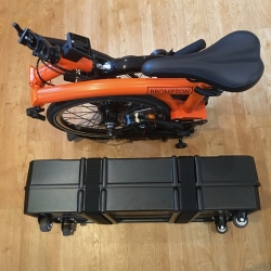 B and W foldon folding bike box - folded next to Brompton