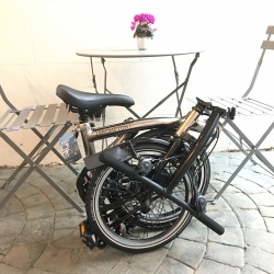 Brompton 2018 NICKEL EDITION S6L - folded in cafe