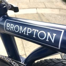 Brompton M6L folding bike - Tempest Blue - showing Brompton logo