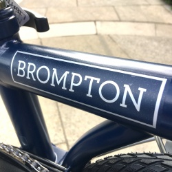 Brompton decal - Silver - BROMPTON - on Tempest Blue bike