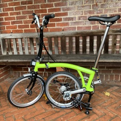 Brompton M6L folding bike - Lime Green / Black - 2019 model - in the local bus stop