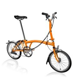Brompton M6L folding bike - Orange - 2020 model - stock photo